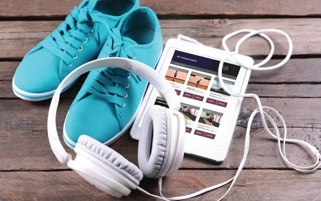 Running shoes, headphones & Amaven on a tablet