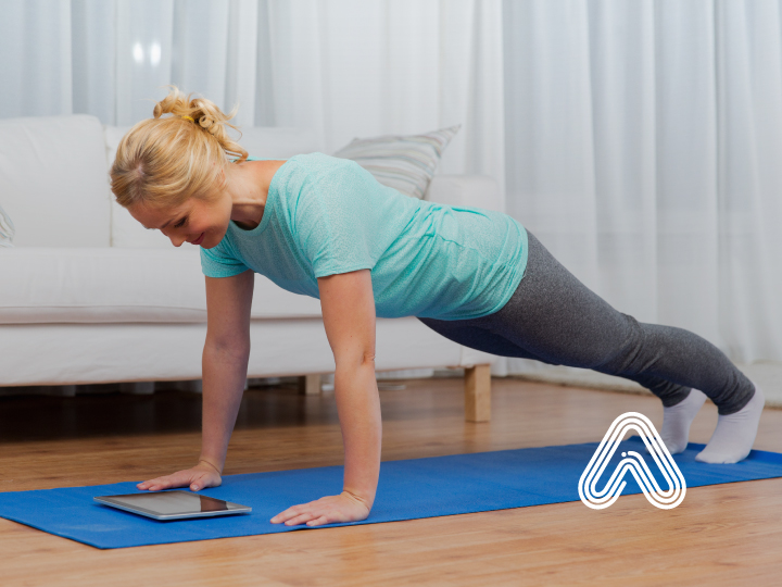 woman doing press up at home