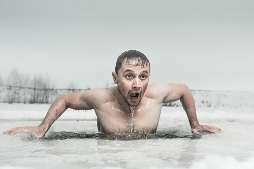 Man taking plunge in ice bath