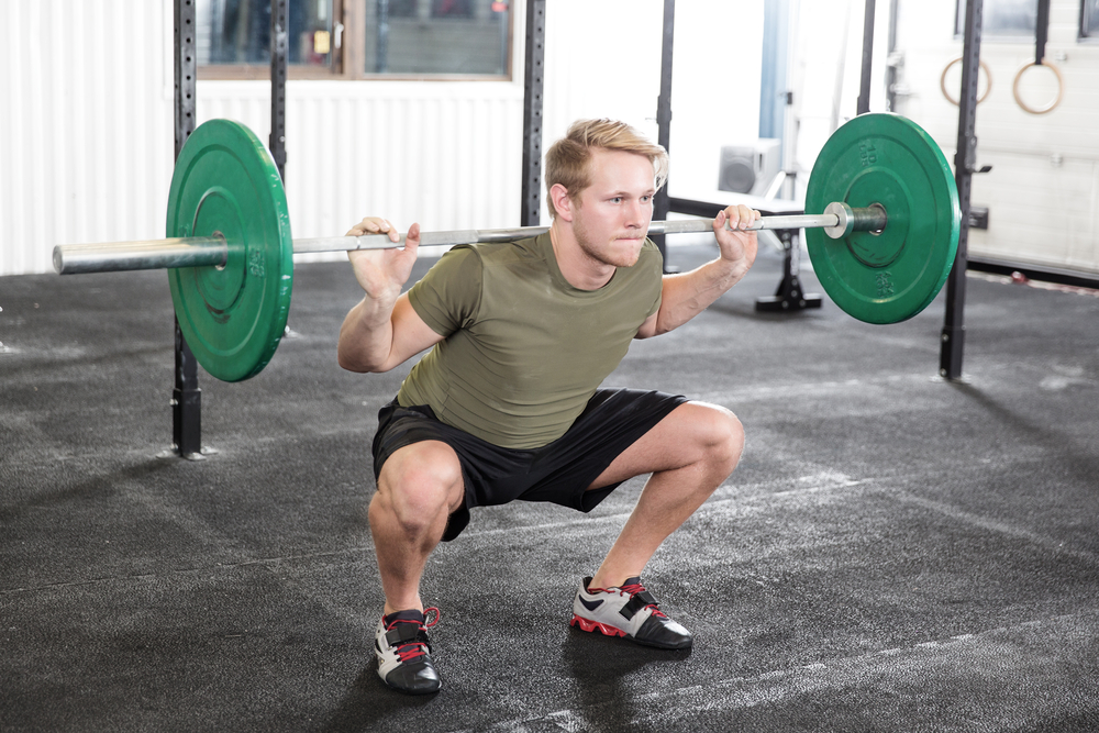 Man doing front weighted squat