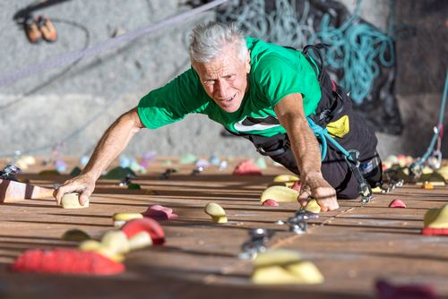 Mature man rocking climbing