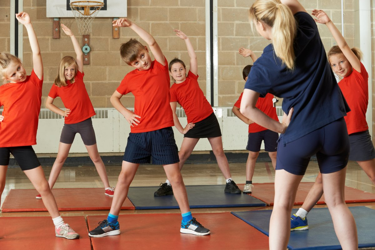 children doing PE in school
