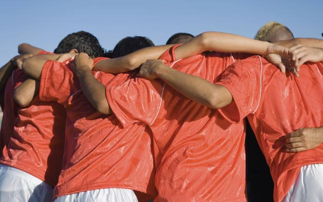 Sports team huddle