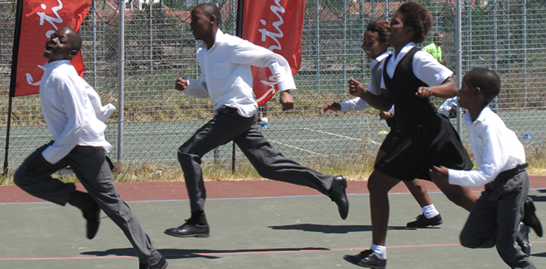 Six School Pupils in Uniform Running
