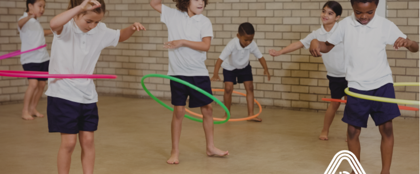 Kids playing with hula hoops in school