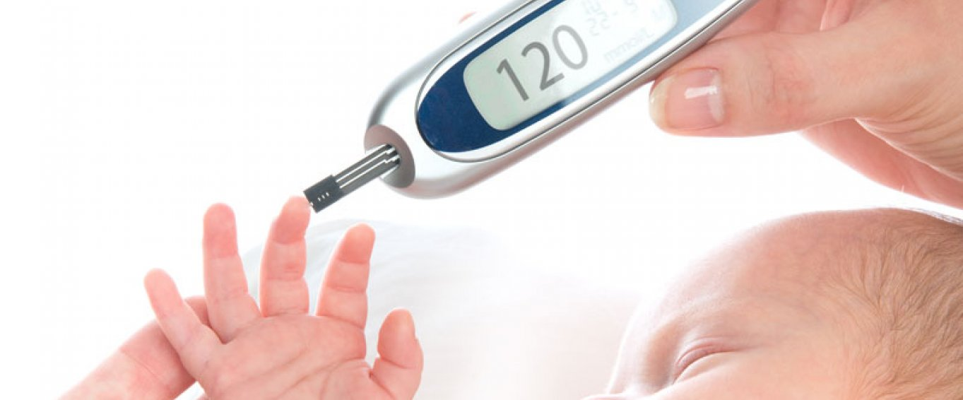 Baby being tested with a thermometer