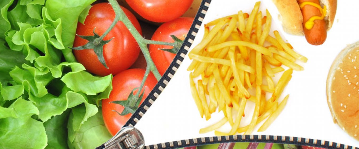 Fruit and veg being unzipped to reveal junk food