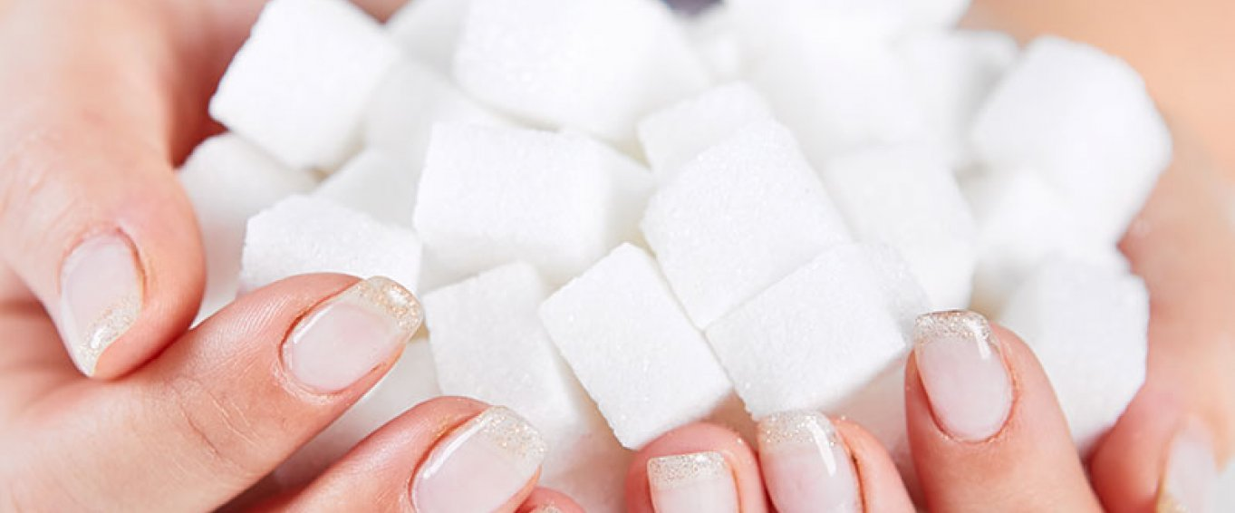 Woman holding sugarcubes