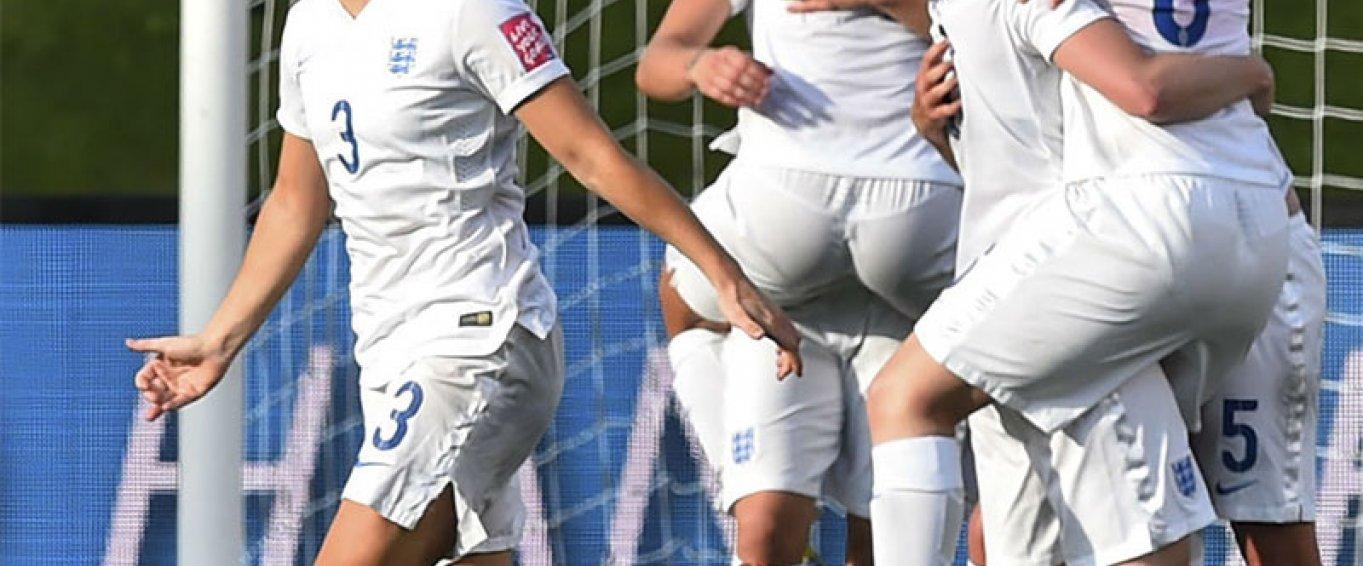 Women's football team celebrating a goal