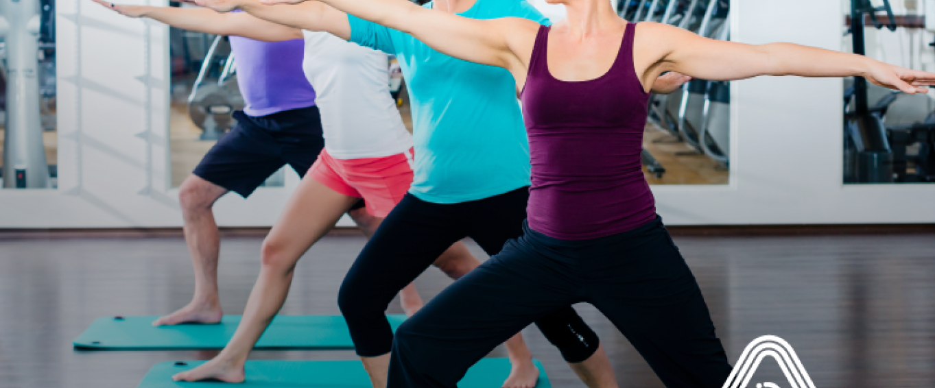 Group of people of different ages doing yoga poses