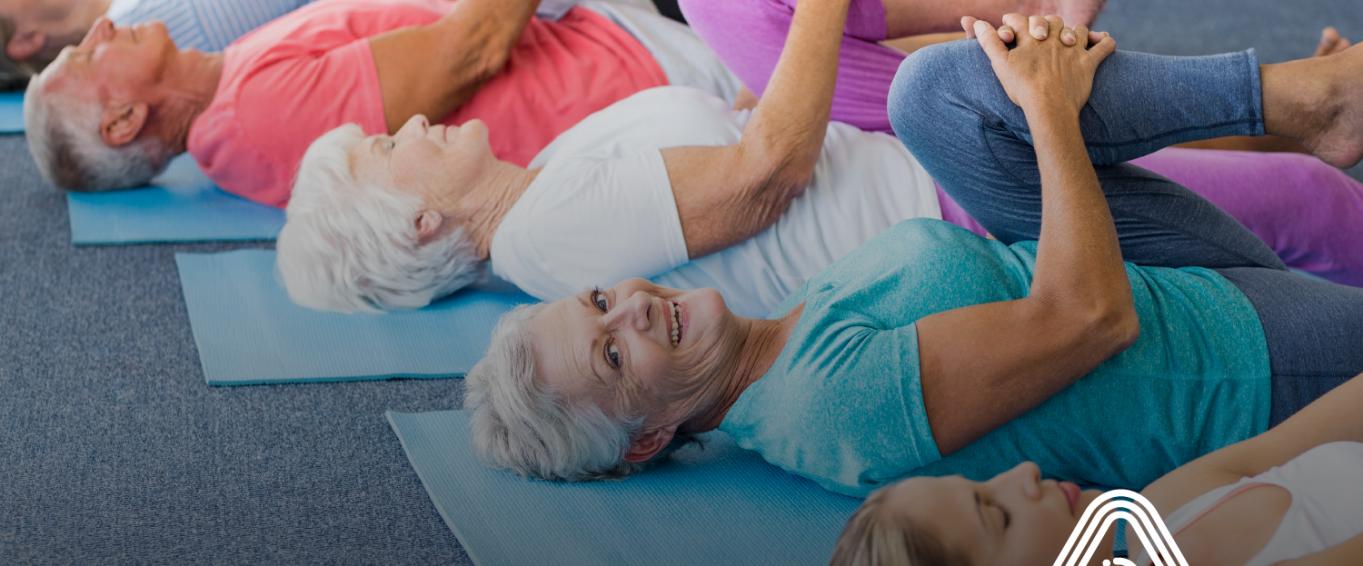 older adults doing exercise on a matt