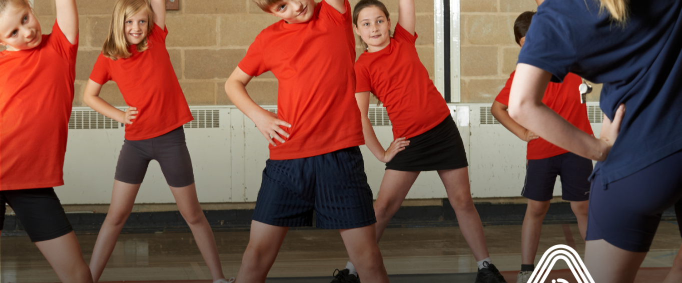 Children doing PE in red t-shirts