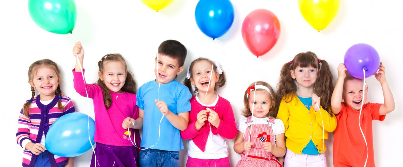 7 Children Holding Colourful Balloons