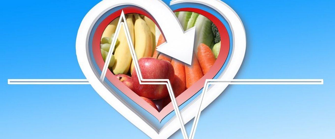 Heart logo with fruit in the centre blue background