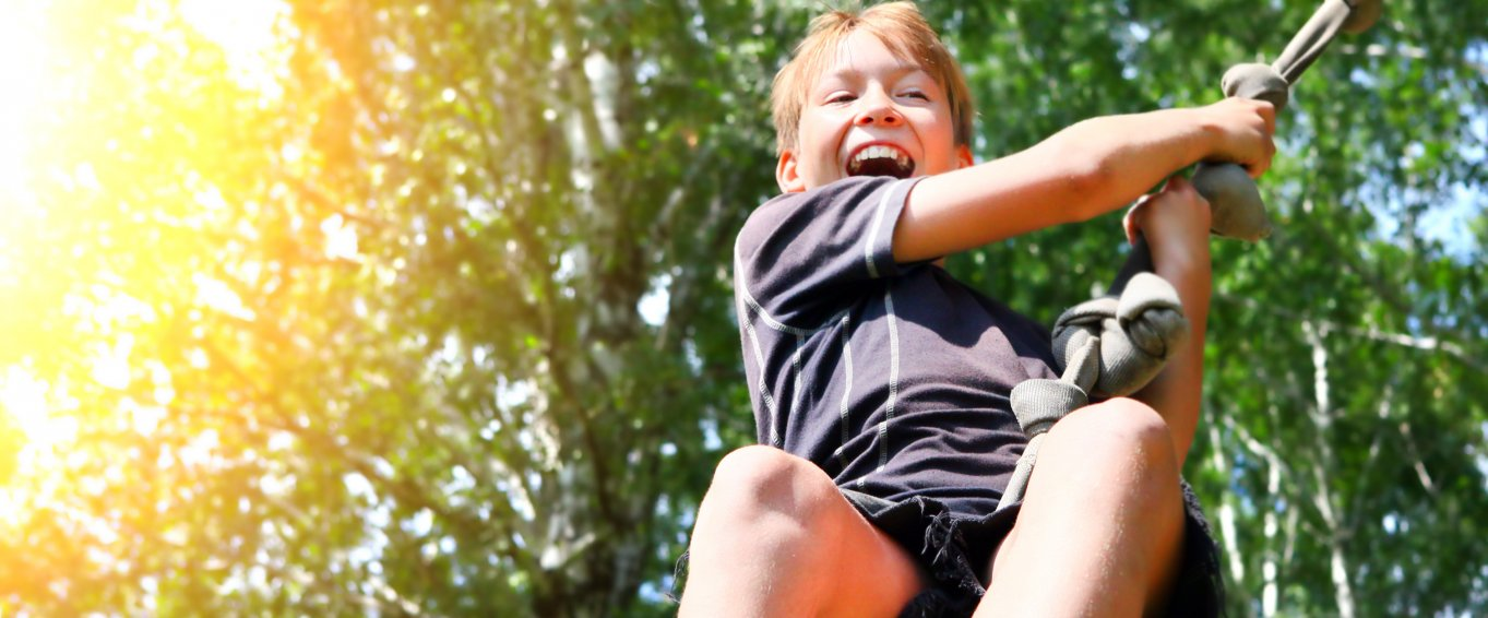 Grinning Child on a Rope Swing