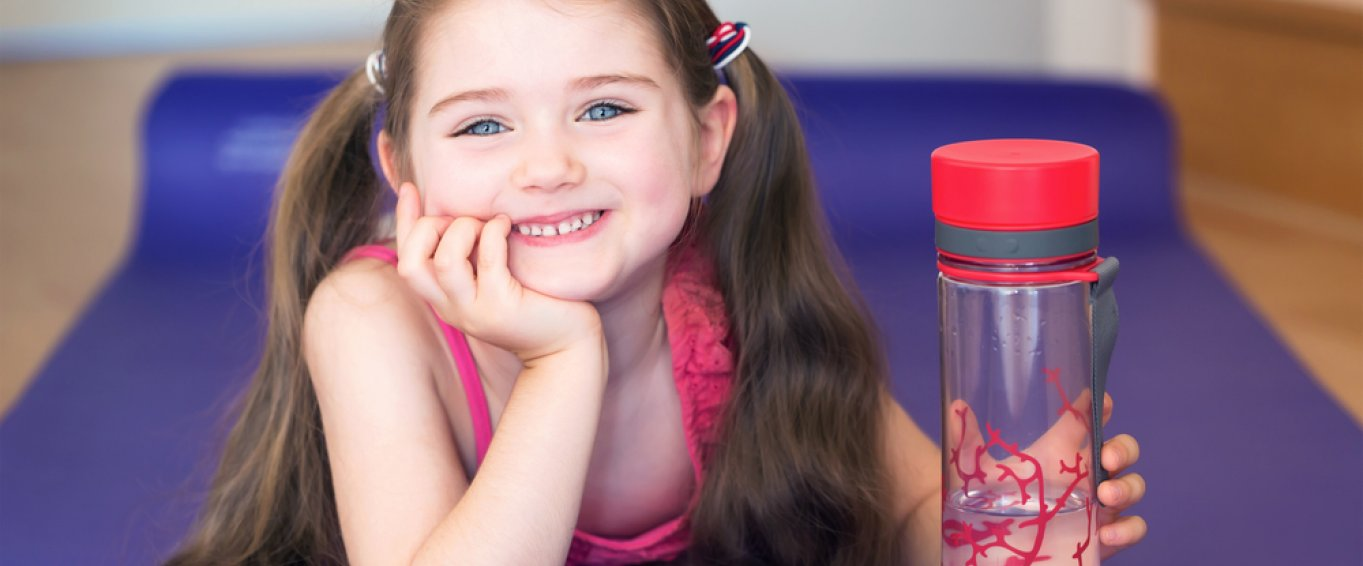 Smiling child holding a water bottle