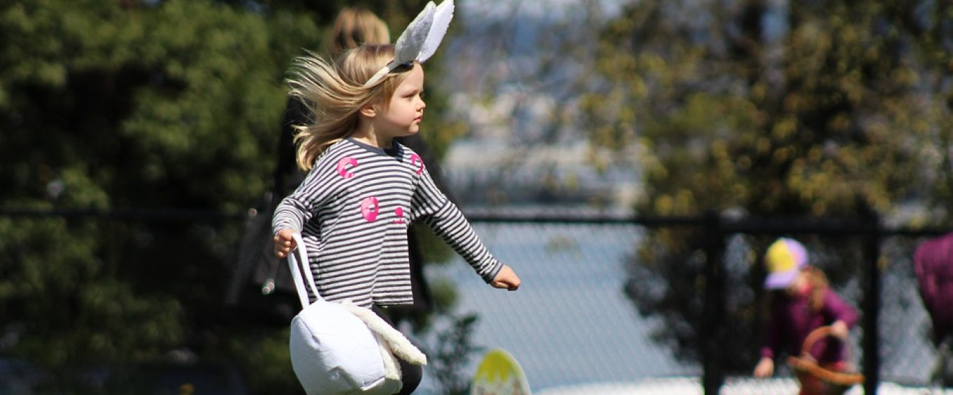 Little Girl with Bunny Ears and an Easter Basket