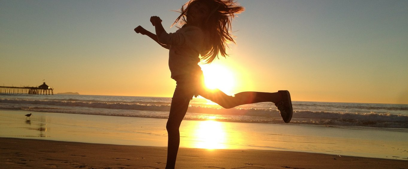 Girl Leaping on a Beach