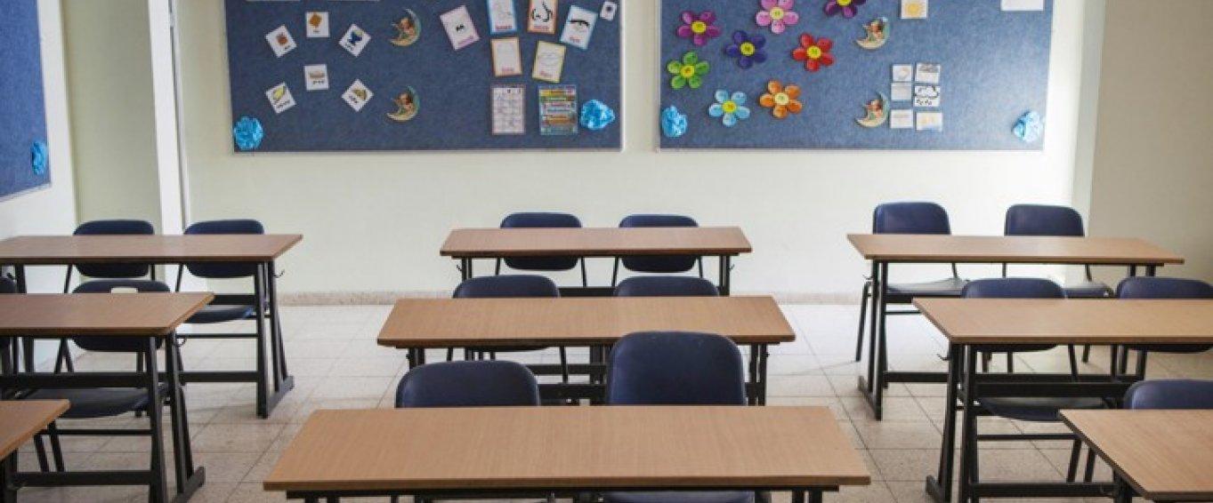Empty Desks in Rows in a Classroom