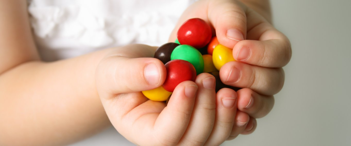 Child holding sweeties