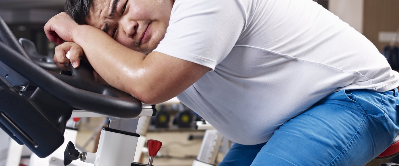 Overweight man on an exercise bike