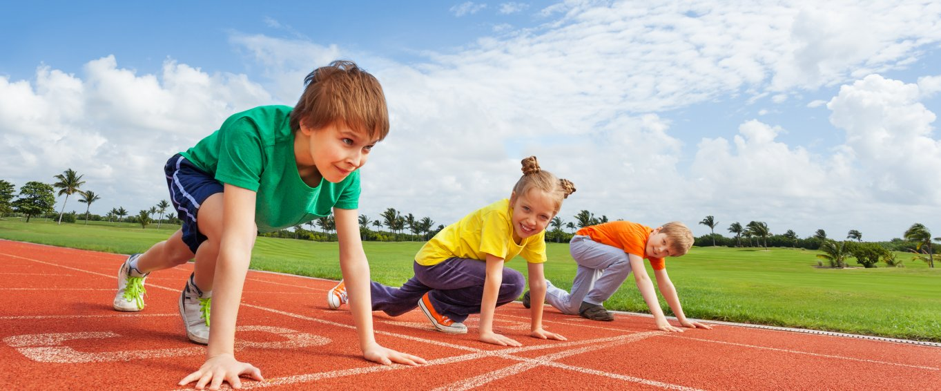children getting ready to run on track