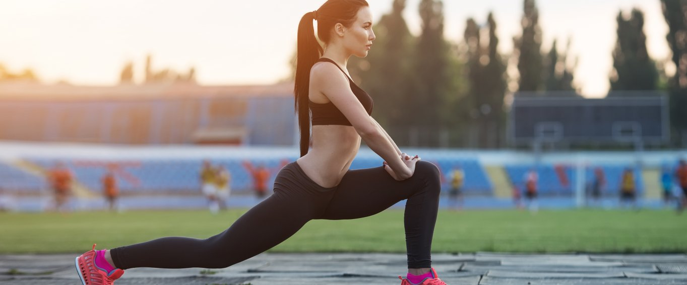Girl squat exercising outdoors