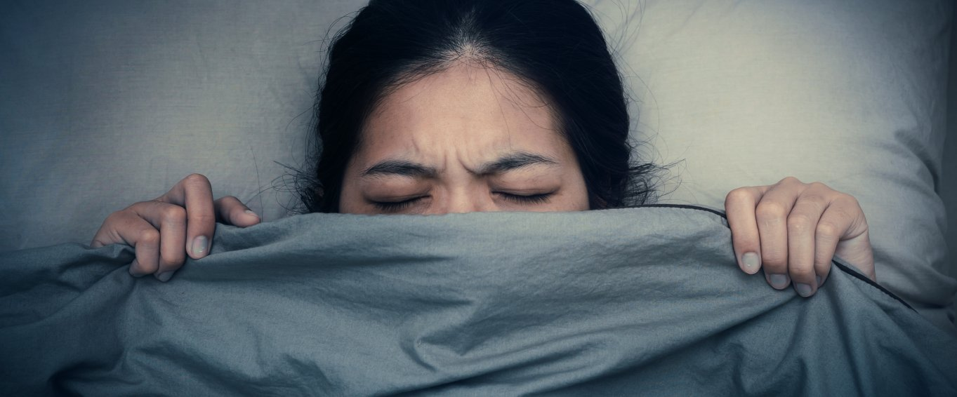 Woman struggling to get to sleep