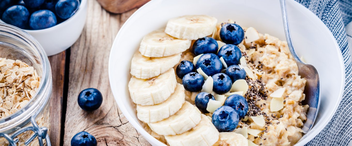 Bowl of porridge with blueberries and banana