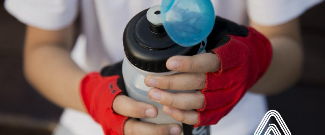 boy holding water bottle