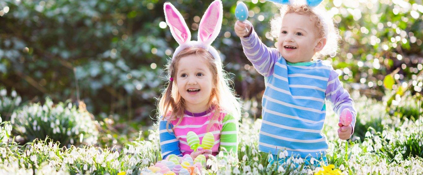 Children in forest doing Easter egg hunt