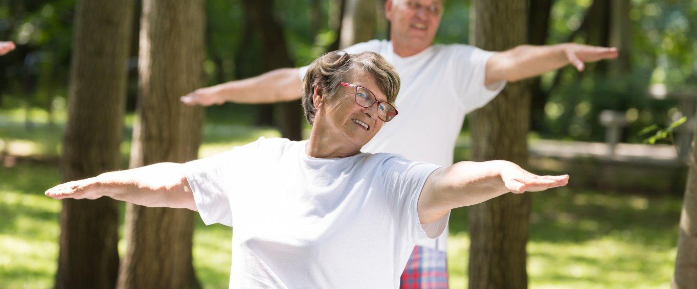 Older adults doing yoga outside