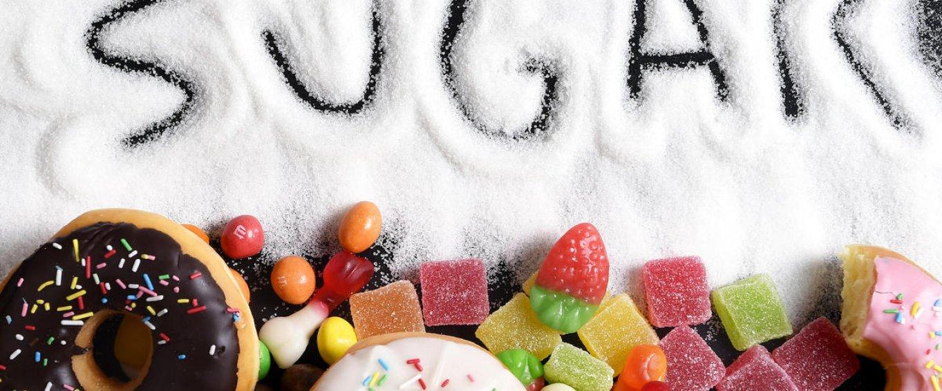 The Word Sugar Written In Granulated Sugar
