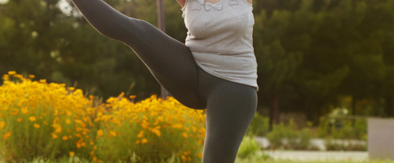 Woman in yoga pants doing stretches