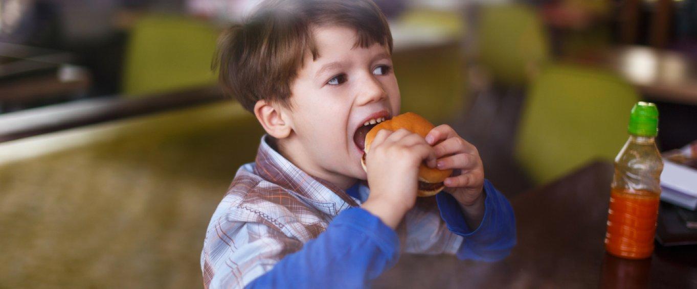 Child eating hamburger
