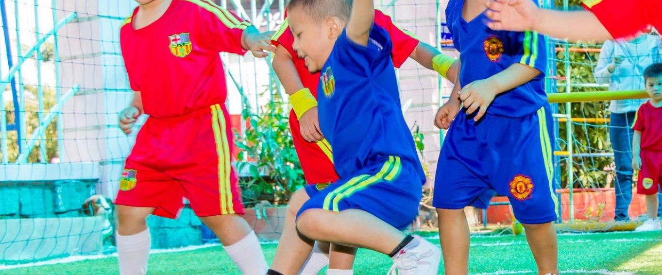 4 children playing football