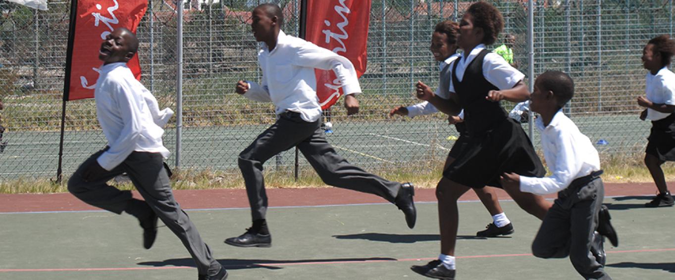 Six School Pupils in Uniform Running