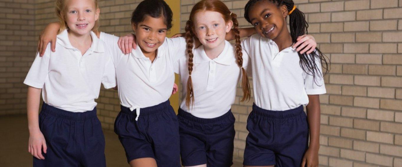 Four Young Girls Posing in School PE Kit