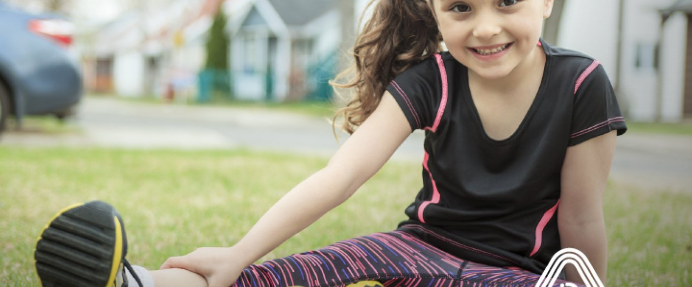 Young girl sat outside sports