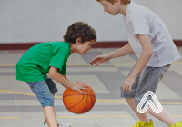 Young children playing basket ball