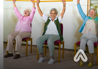 Older ladies exercising while sat down