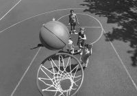 Young Children Shooting Basketball Hoops