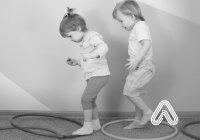 Kids playing with hula hoops fundamental movement skills