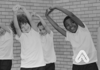 Children stretching in PE lesson