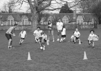 primary school kids playing football