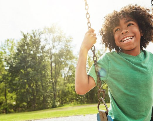 Young Boy Sitting on a Swing