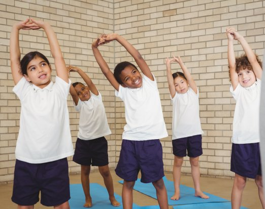 Young Kids Performing a Stretch