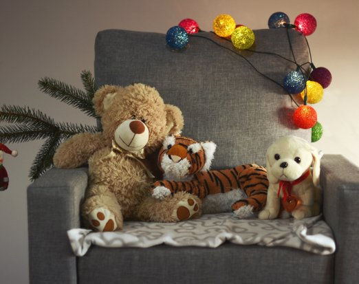 Armchair with stuffed toys and Christmas decorations