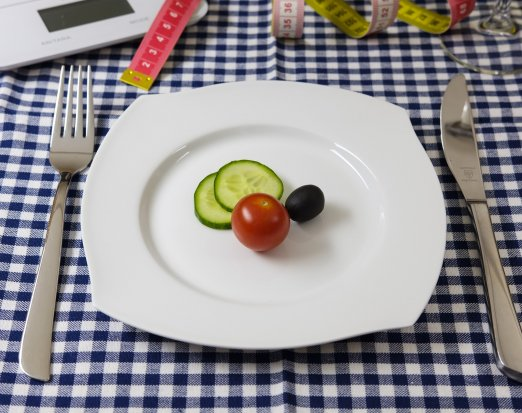 Dinner Plate with Slices of Cucumber and a Tomato