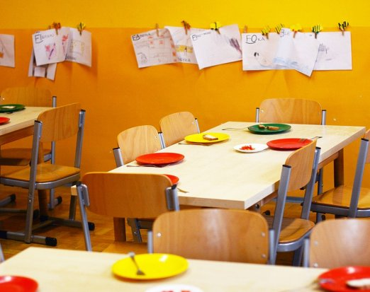 School Dining Hall with Plates Set for Lunch